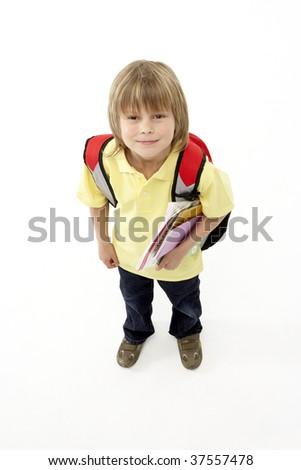 Studio Portrait of Smiling Boy Holding Books - stock photo