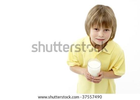 Studio Portrait of Smiling Boy Holding Glass of Milk - stock photo