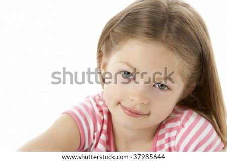 Studio Portrait of Smiling Girl - stock photo