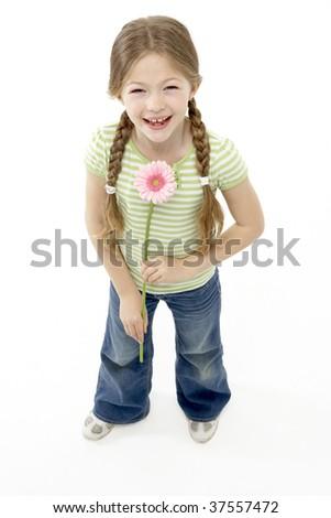 Studio Portrait of Smiling Girl Holding Flower - stock photo
