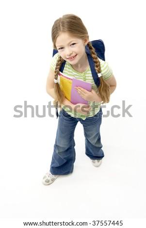 Studio Portrait of Smiling Girl Holding School Book - stock photo