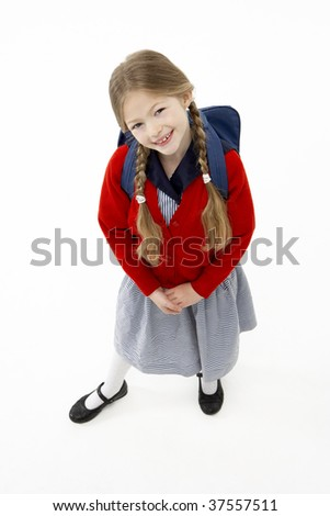 Studio Portrait of Smiling Girl Wearing School Bag - stock photo