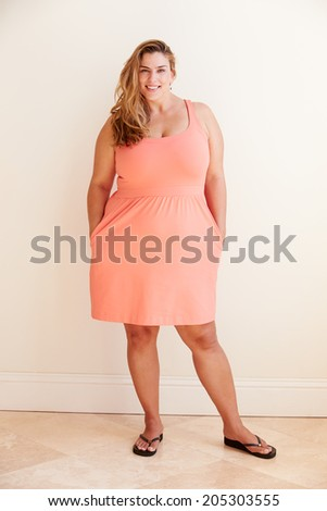Studio Portrait Of Smiling Overweight Woman - stock photo