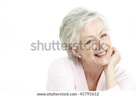 Studio Portrait Of Smiling Senior Woman - stock photo