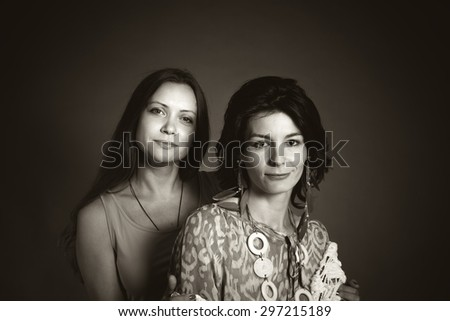 Studio portrait of two girlfriends - stock photo