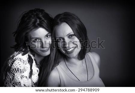 Studio portrait of Two happy girlfriends - stock photo