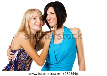 Studio portrait of two young beautiful friends, white background - stock photo