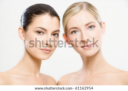 studio portrait of two young beautiful women - stock photo