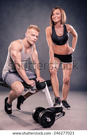 studio portrait of two young bodybuilder - stock photo