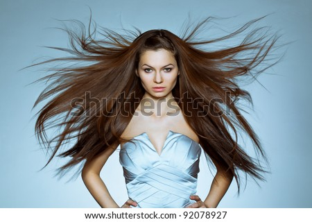 studio portrait of woman with flying hair - stock photo