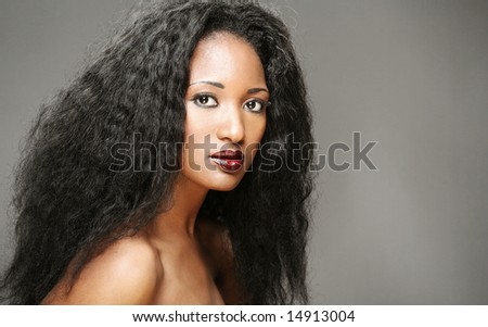 studio portrait of young african american woman - stock photo