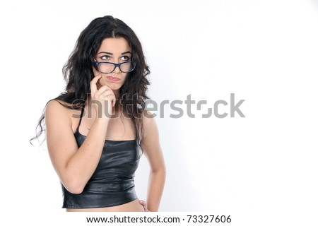 studio portrait of young attractive woman wearing glasses - stock photo