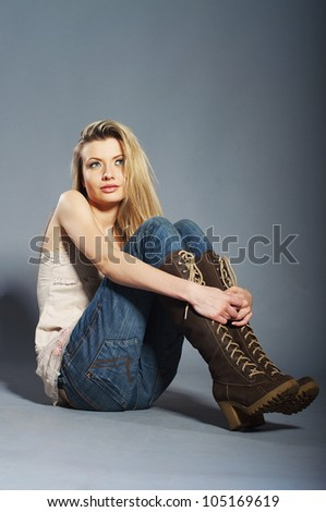 Studio portrait of young beautiful blond girl - stock photo
