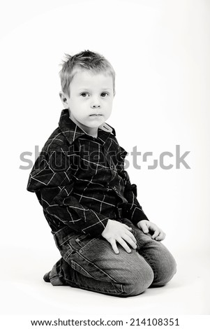 Studio portrait of young beautiful boy black and white - stock photo