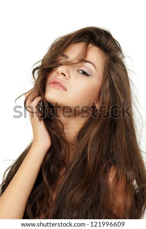 studio portrait of young beautiful brunette woman against white background - stock photo