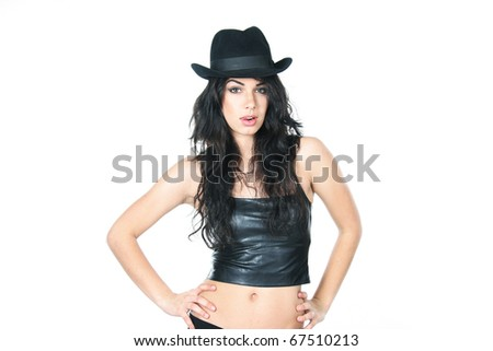 studio portrait of young beautiful woman in black hat over white