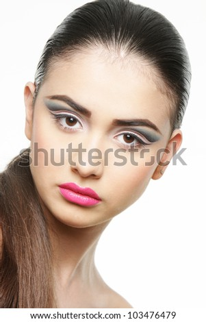 studio portrait of young beautiful woman with bright makeup isolated over white - stock photo