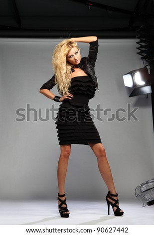 studio portrait of young blond woman - stock photo