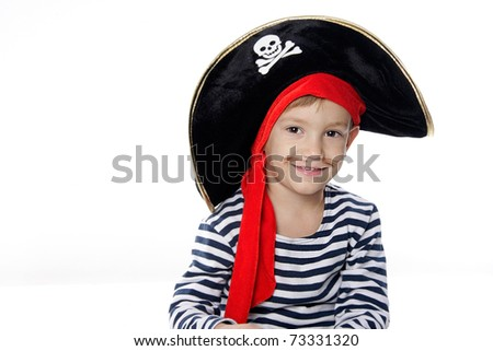 studio portrait of young boy dressed as pirate - stock photo