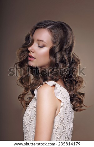 Studio Portrait of Young Dreamy Brunette with Closed Eyes - stock photo