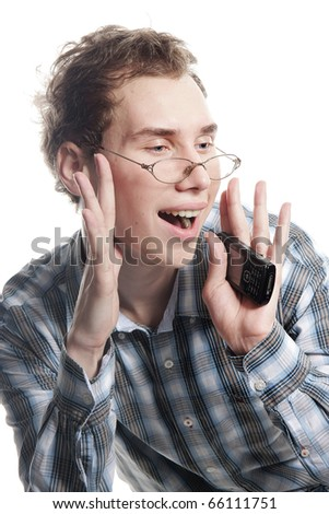 studio portrait of young handsome man with phone over white - stock photo
