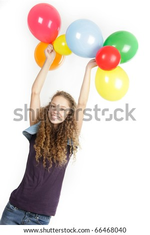 studio portrait of young happy girl with colorful balloons over white - stock photo