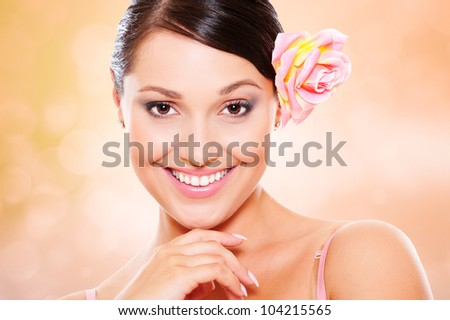 studio portrait of young smiley woman against blurred background - stock photo
