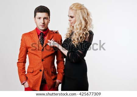 Studio portrait of young stylish beautiful couple in love