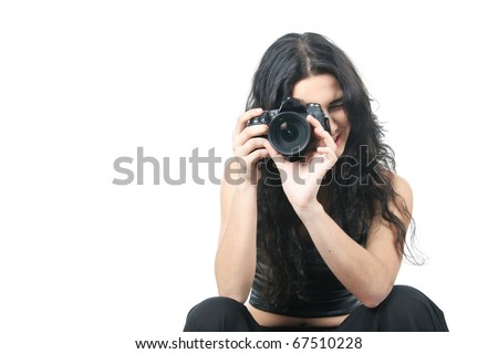 studio portrait of young woman taking picture over white - stock photo