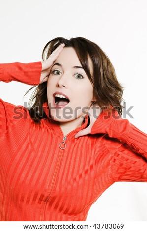 studio portrait on isolated background of a beautiful  caucasian expressive woman amazed - stock photo