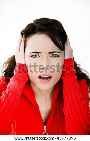 studio portrait on isolated background of a beautiful  caucasian expressive woman suffuring loud sound - stock photo