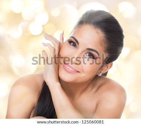 Studio portrait on white of a beautiful smiling woman - stock photo