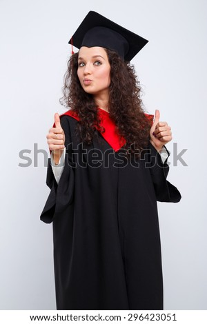 Studio portrait picture from a young graduation woman