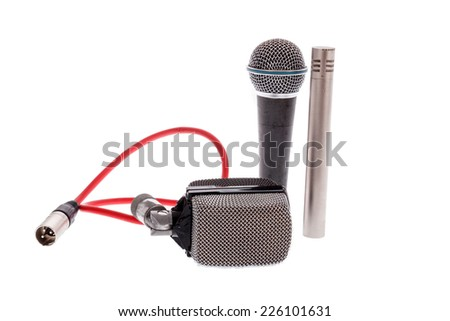 studio recording groups of vintage  microphones for lead vocal on live gig  or for drums ,  music instruments for performance isolated on white - stock photo