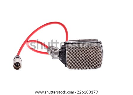 studio recording  vintage  microphone with red cable for lead vocal on live gig  or for drums ,  music instrument for performance isolated on white background - stock photo