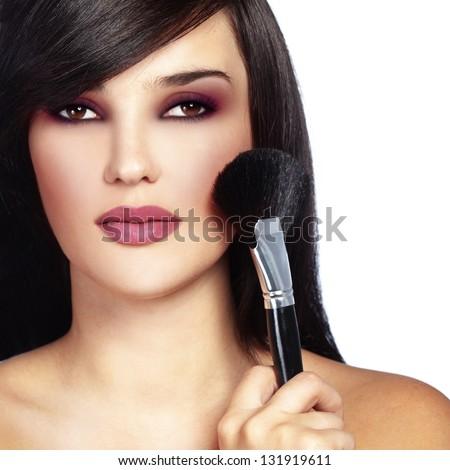 Studio series of doing fashion makeup - stock photo