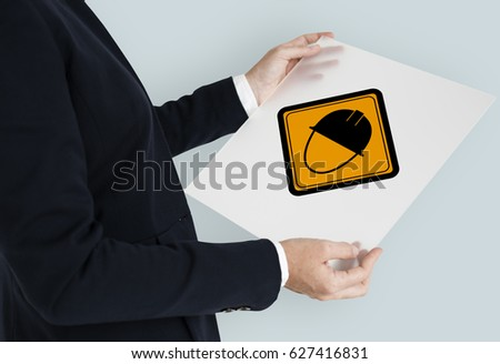 Studio Shoot Holding Banner with Safety Helmet Attention Sign