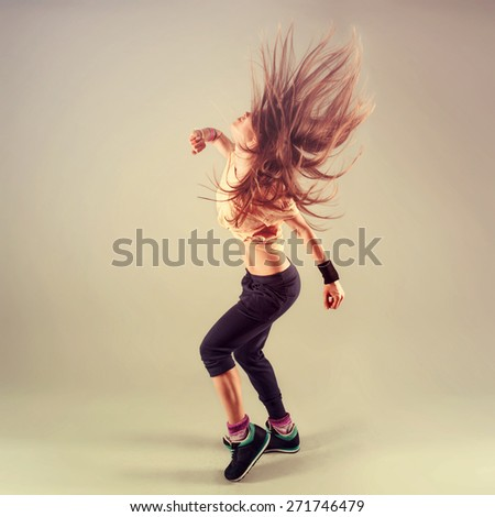 Studio shoot of active female funk jazz dancer moving. Sport and leisure concept. Zumba Dance. - stock photo
