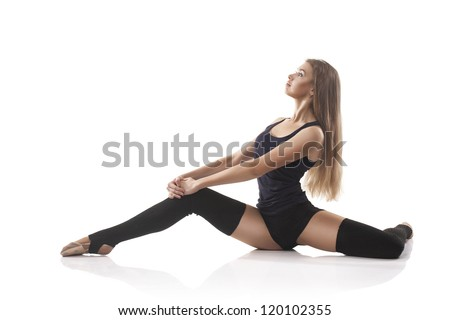 studio shoot of cute woman gymnast isolated on white background