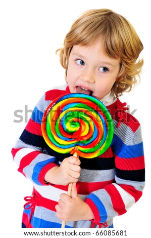 studio shoot of girl with huge lollipop - stock photo