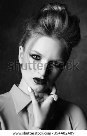 Studio shoot of posing woman. Retro style. Creative make up and hairstyle. Stock photo.