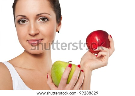 Studio shoot of smiling woman with red and green apple on a white background