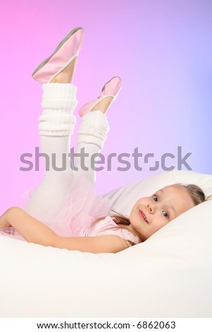 Studio shoot of 4 years old girl dressed as ballet dancer - stock photo