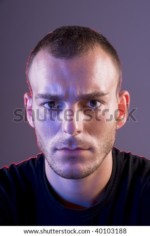 Studio shoot of young caucasian angry man