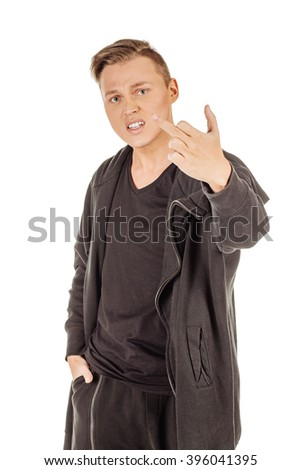 Studio shot angry young man showing middle finger  and looking at the camera isolated on white background.Negative human emotions facial expression feelings attitude - stock photo