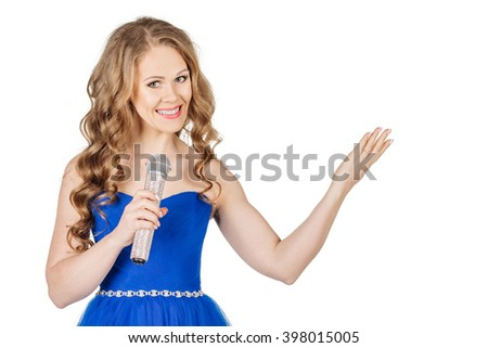 Studio shot beautiful young singing girl in elegant blue dress looking at the camera with rhinestone microphone. image on a white studio background. - stock photo