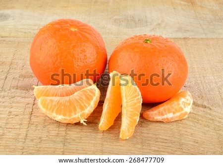 Studio shot mandarines, tangerines on wooden table on white with pieces