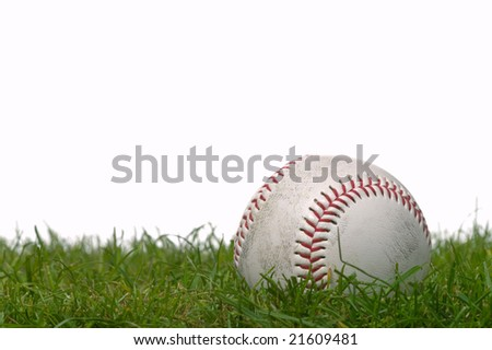 Studio shot of a baseball on grass, white background.