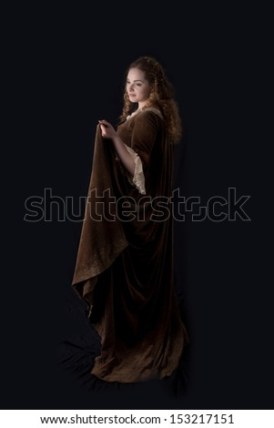 studio shot of a beautiful lady in medieval dress - stock photo