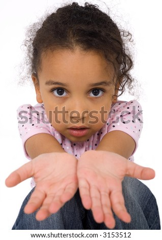 Studio shot of a beautiful mixed race girl with her hands outstretched in front of her. The background has been dropped out.